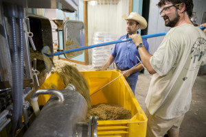 Grain is taken from First Magnitude Brewery and loaded into buckets for cattle feed at the UF IFAS Beef Teaching Unit.