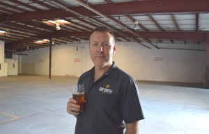Due South owner Mike Halker standing in the new space.