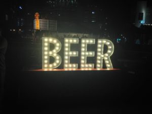 "Lighted sign says ""Beer"""