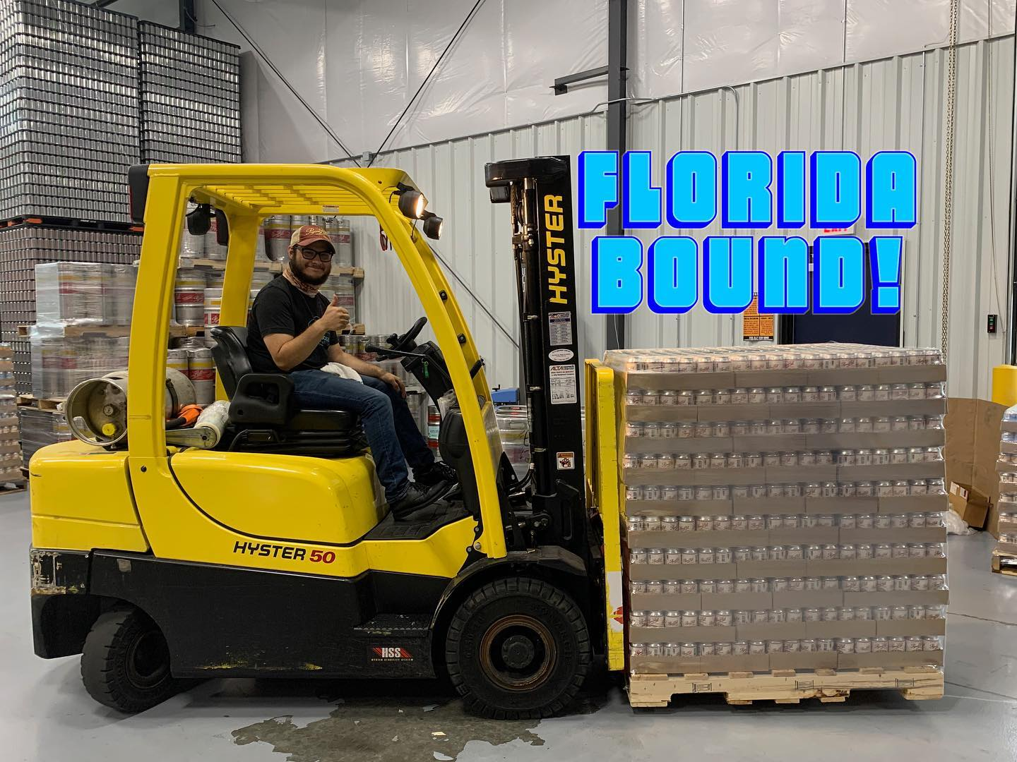 """Pigeon Hill is Florida Bound. Man on forklift with """"Florida Bound"""" in text."""